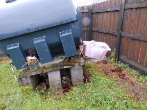 Oil-tank-leak-in-garden_tap-open-oil-clean-up-oil-spill-cleanup
